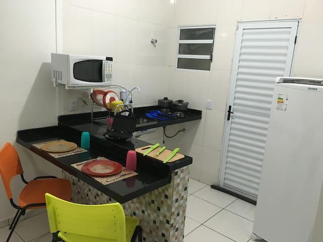 Apartamento com cozinha, garagem e churrasqueira 1 - Bertioga - Hus