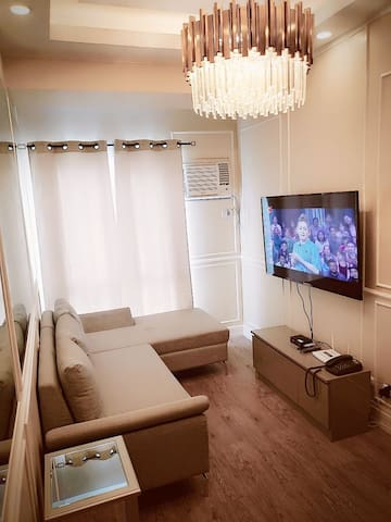 Sit back and Relax in Our Sala Livingroom. Lounge in the Sofa Chaise  and enjoy our LED HDTV with cable service.