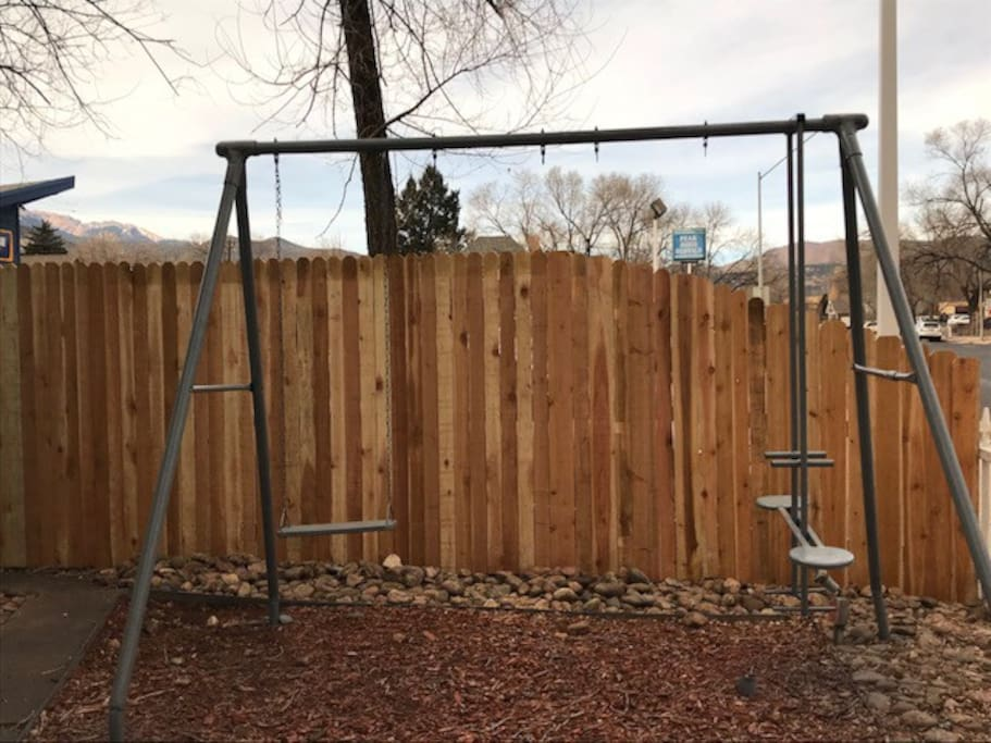 Swingset w/fenced front yard.