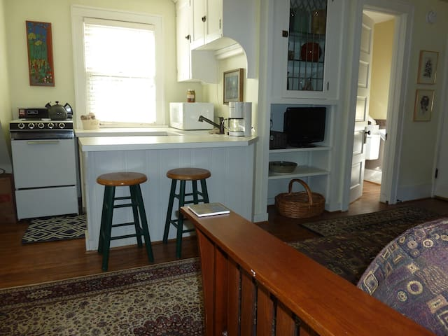 Looking south into the kitchen. Cooking utensils, coffee maker, toaster, microwave, etc. are provided.
