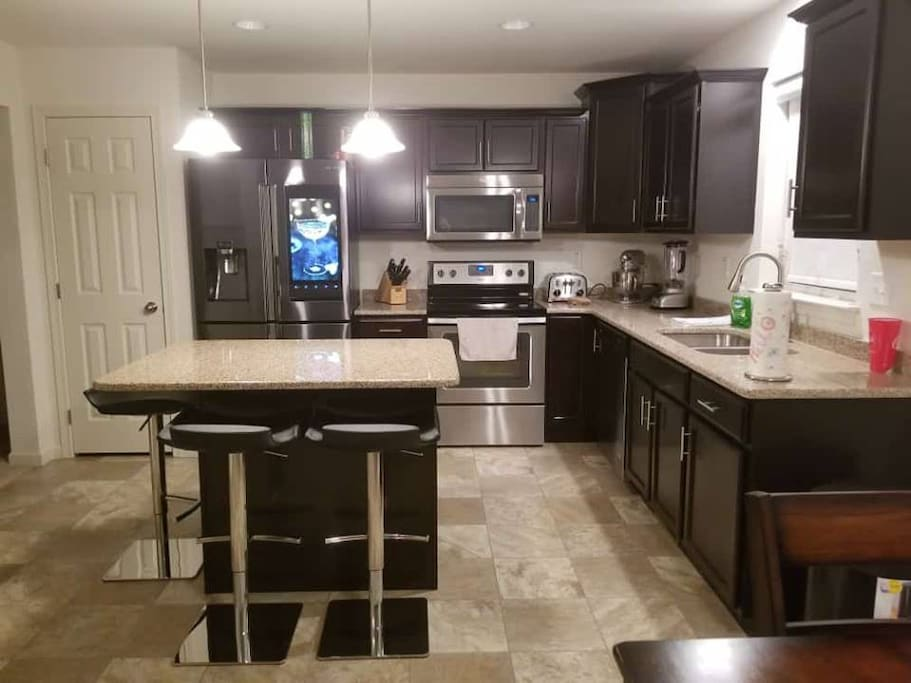 Spacious kitchen with top of the line cookware and all the gadgets you can think of. Opens into the living room so you can be apart of the conversation while everyone else is gathered in the living room.