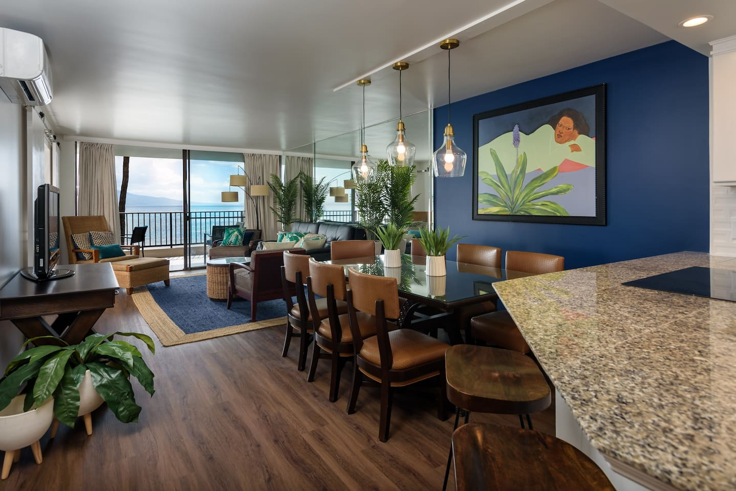 Living room and dining area looking towards the ocean.