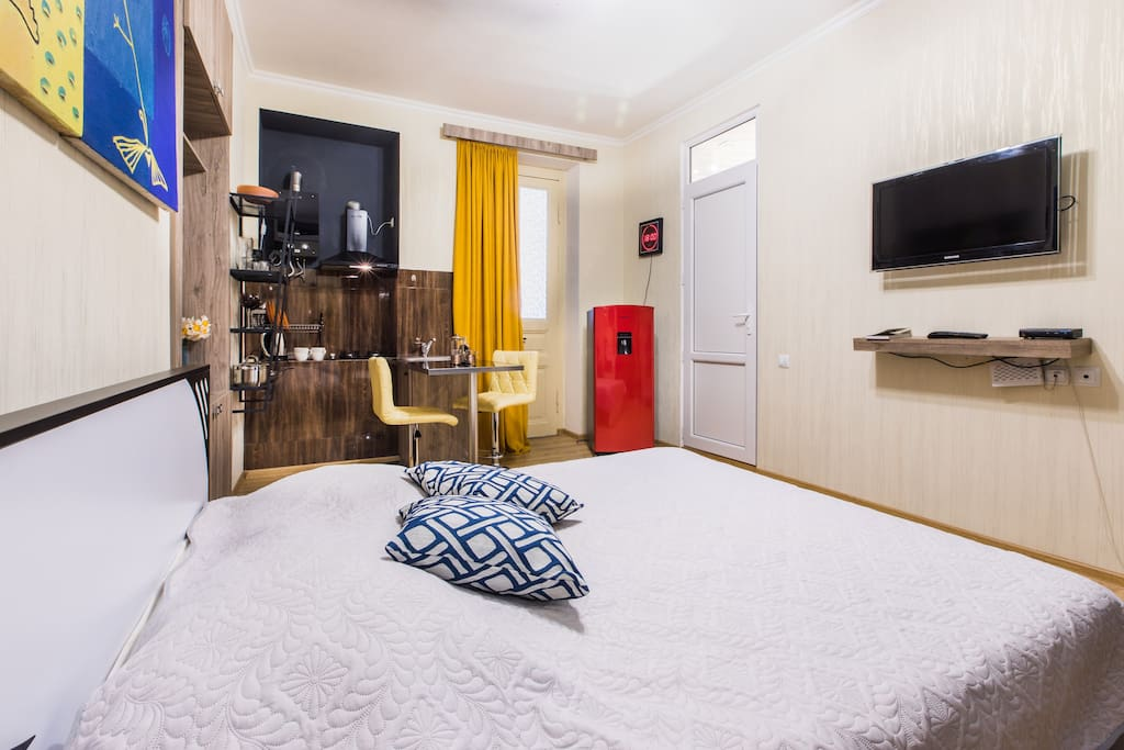 Comfortable double bed and a large flat screen TV that shows numerous local and international channels.