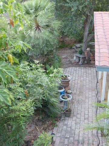 View from balcony of yard with privacy fence