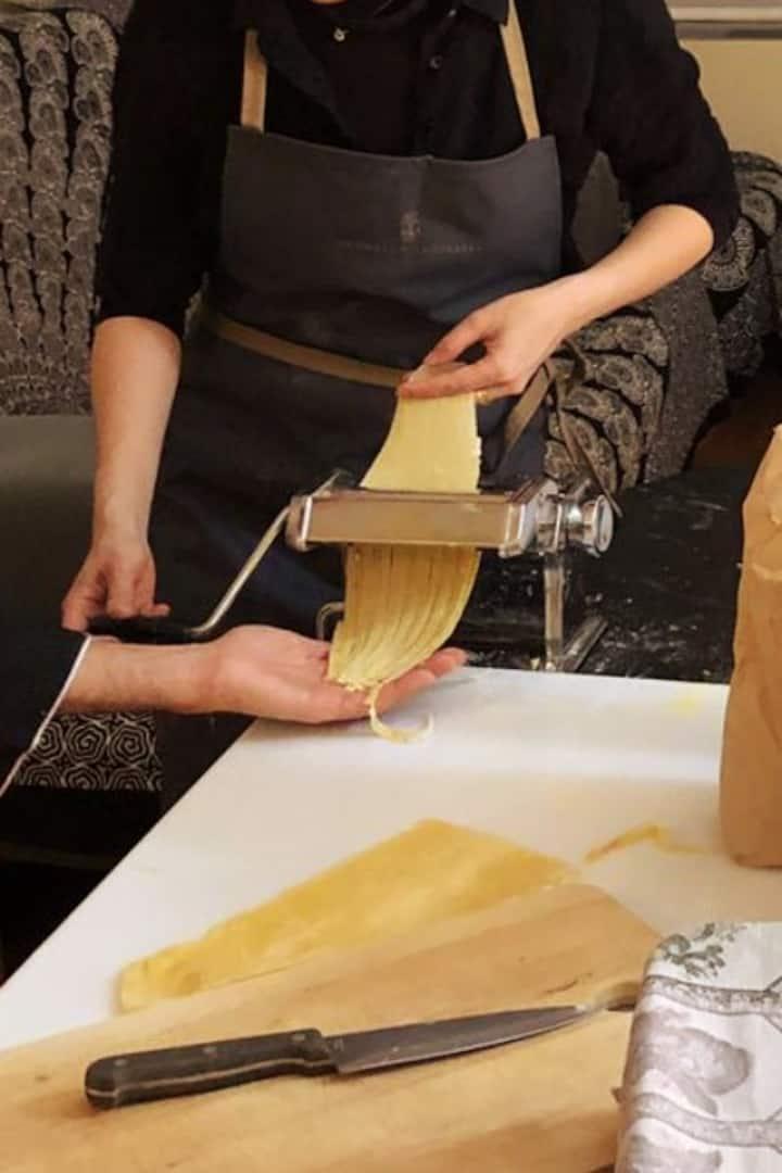Cutting the pasta into Tagliatelle