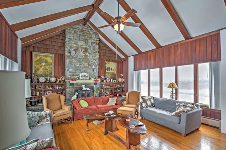 Cathedral ceilings, wooden beams and a stone fireplace add the to the ambiance.