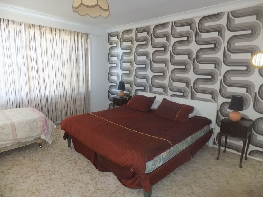 double bedroom with king bed and a single