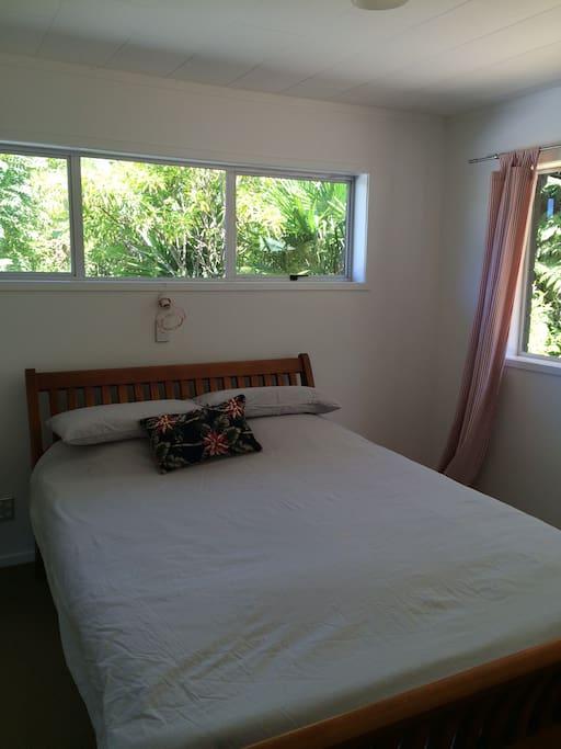 Bedroom with Queen bed overlooking garden