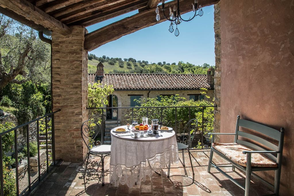 Il Molino's covered terrace - an ideal breakfast spot in the sun
