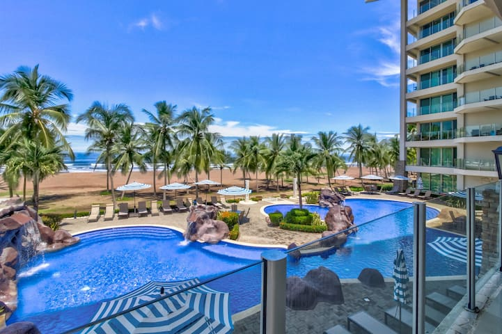 Modern, oceanfront condo with ocean and pool views, easy beach access!