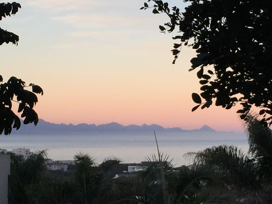 Sunset reflections over the bay and the Tsitsikamma mountains viewed from The Holliday Pad verandah!