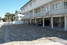 Exterior of the condo looking in from the beach.  Step out the door and take 20 steps and you are in the sand!