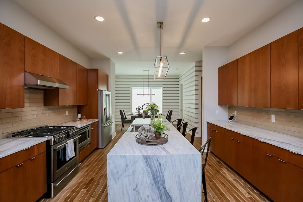 Contemporary cabinets and marble counter tops in the kitchen