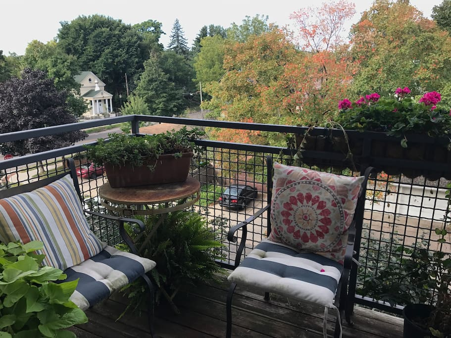 Two spacious outdoor terraces with beautiful views — complete with gas grill and comfortable lounge seating.