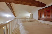 The loft has a full sized bed.