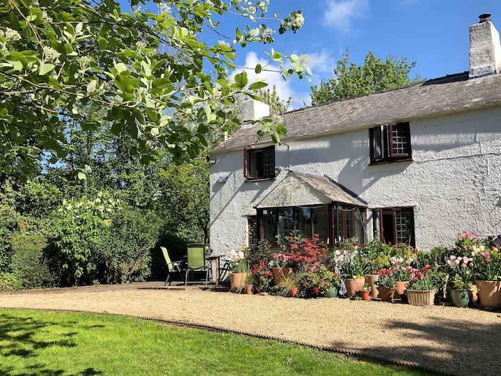 Country cottage with private woodland and orchard.