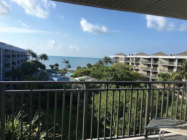 Penthouse condo- ocean views - on beach!