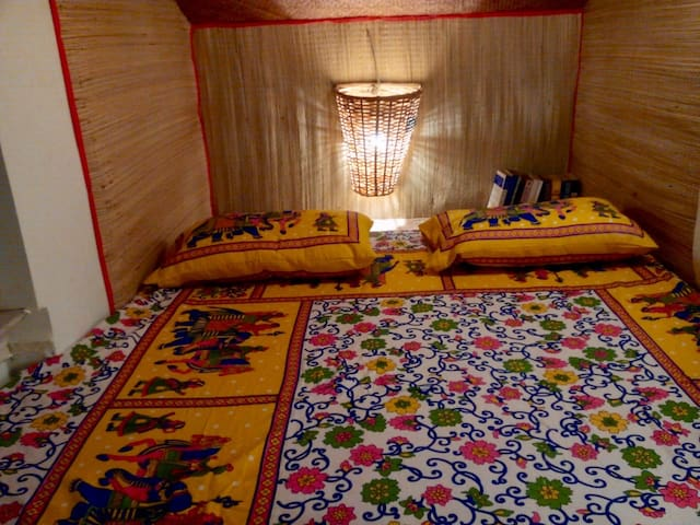 A queen bed with windows on both sides