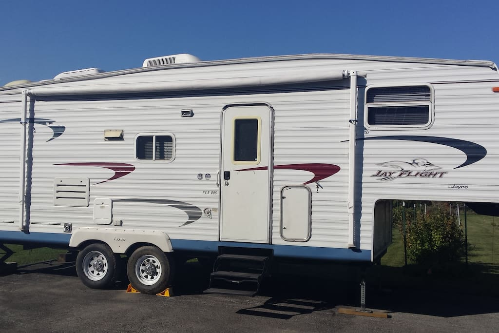 24.5 foot camper with pull-out awning, outdoor grill, and all of the good life!