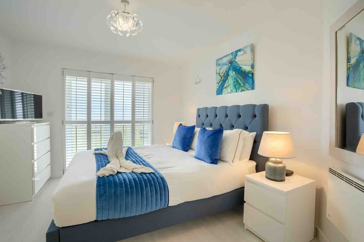 Our stunning master bedroom with plantation shutters with amazing views and access to our terrace
