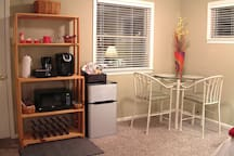 The eating area with refrigerator and separate freezer area.  Microwave, Keurig Coffee Maker.