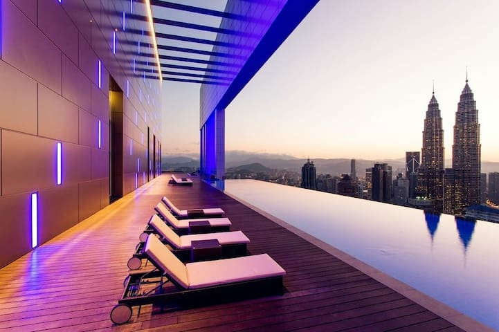 Infinity Pool facing twin towers and KL city scenery