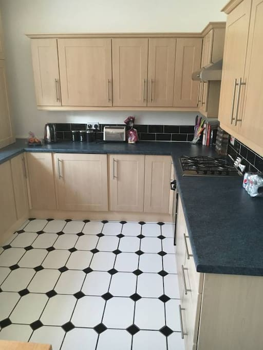 Kitchen fully equipped including washer dryer.