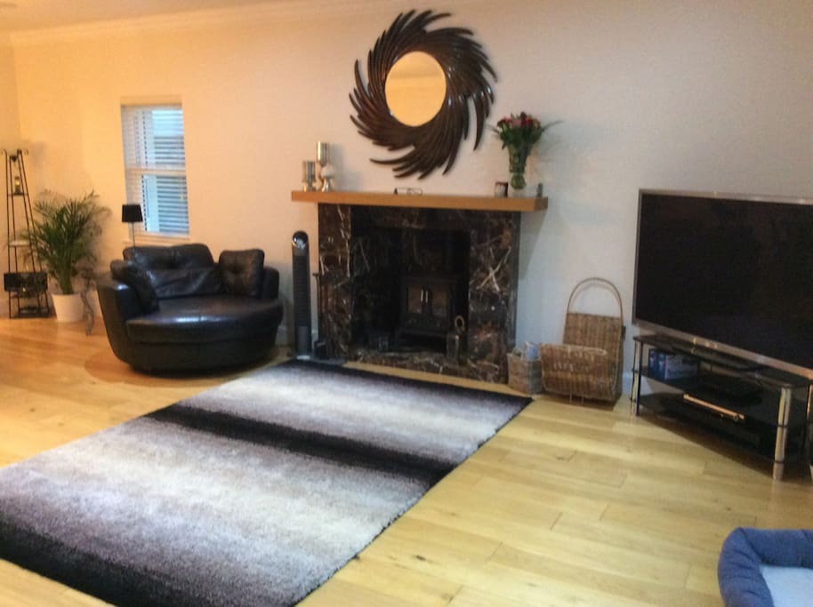 """Family living room with log burner and 60"""" television with Sky"""