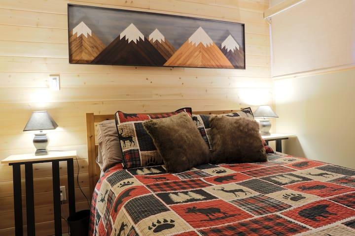 Master bedroom c/w Roku Tv & floor fan