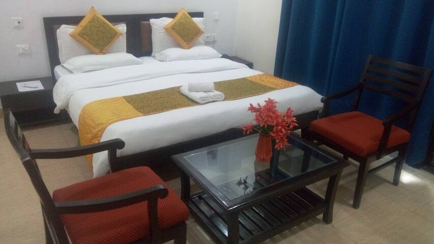 Deluxe Room · Centrally Located @ Dwarka - By Golden Palm Suites