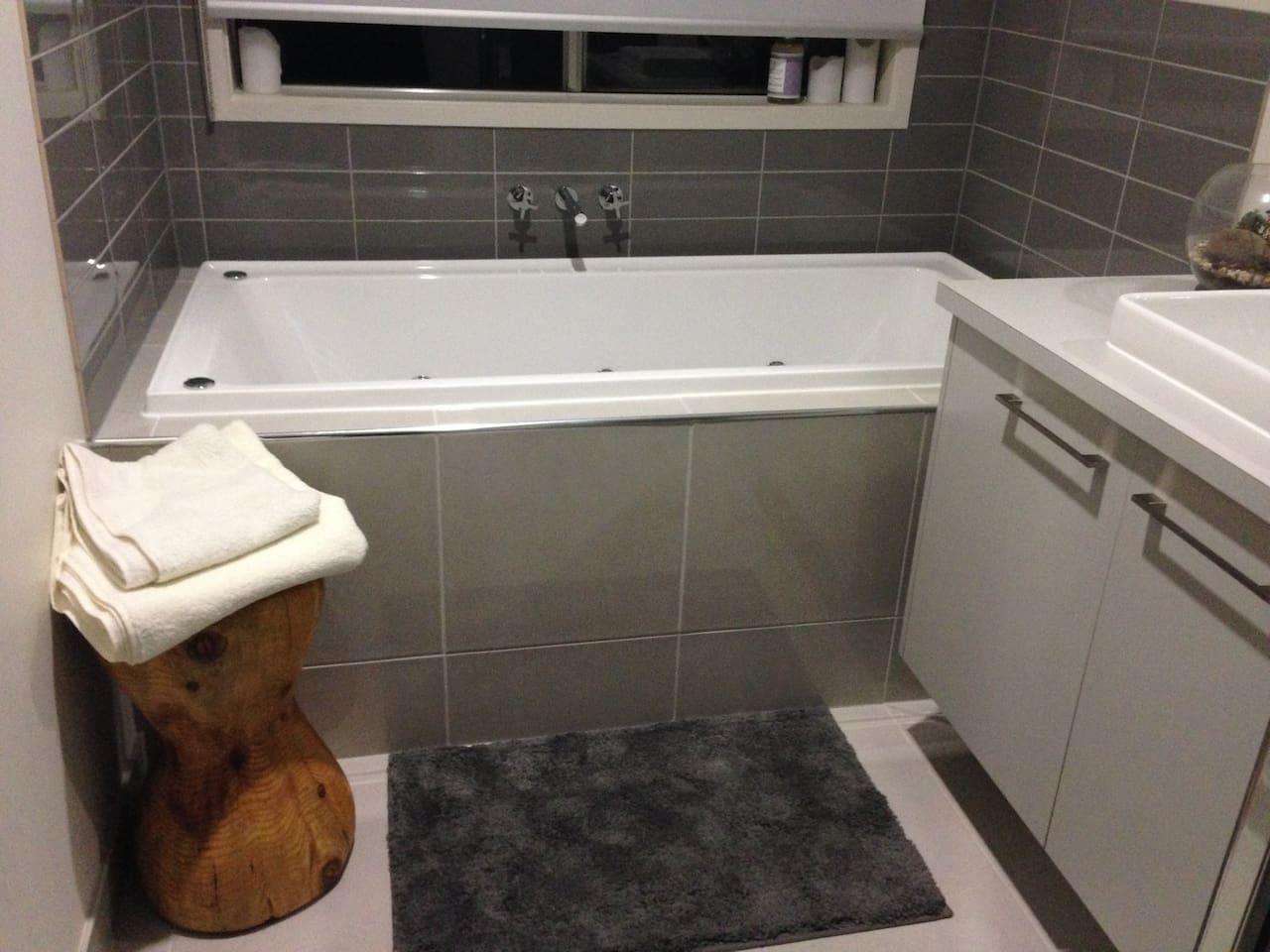 Private bathroom with spa, for guests use only. Liquid soap provided as well as a hair dryer and shampoo and conditioner.