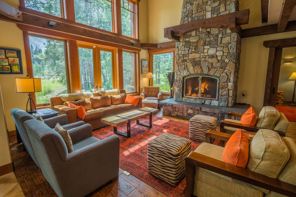 Comfortable great room furniture and a large ledgestone gas fireplace.
