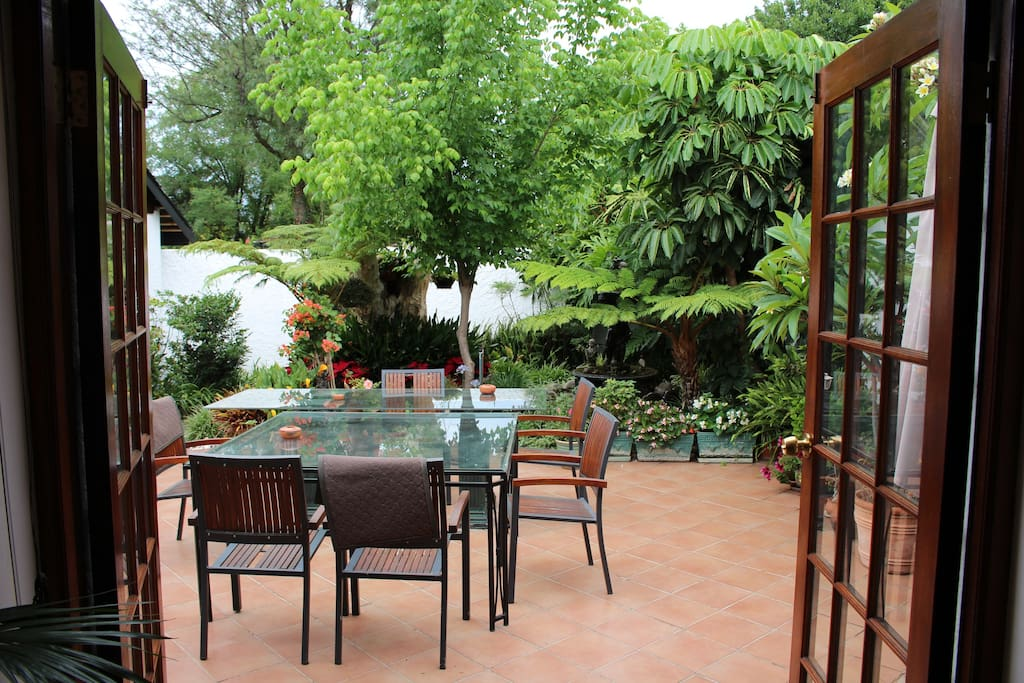 Direct access to enclosed patio with fountain and garden umbrellas