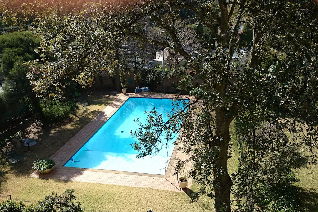 Our apartment complex's Pool with braai (BBQ) facilities on the left. Garden is on the right.