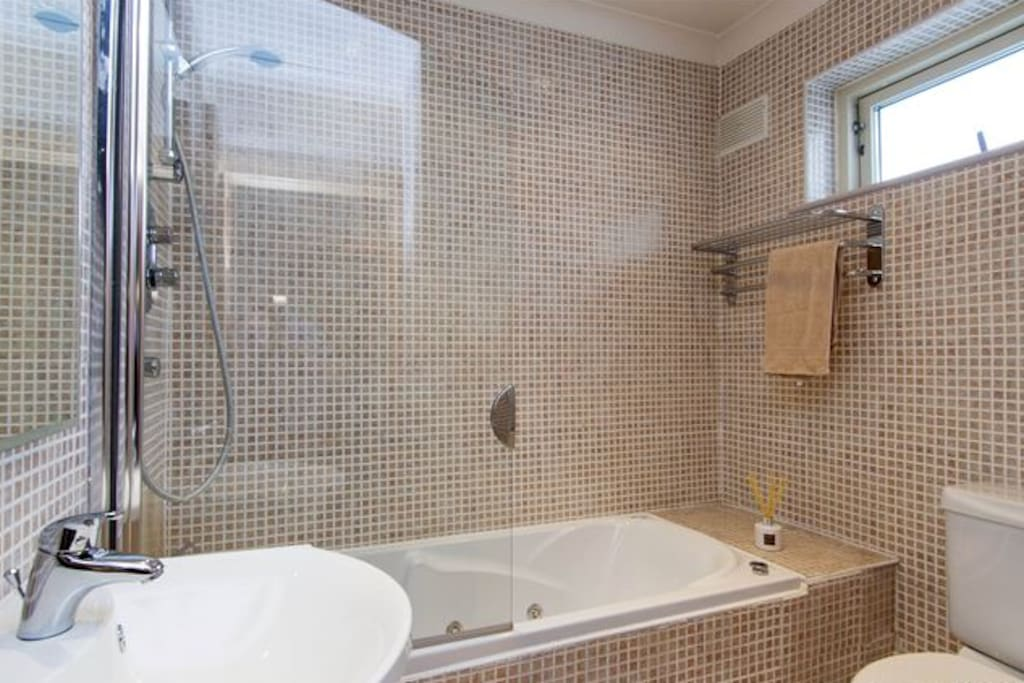 You have access to a private bathroom with a shower & jacuzzi bath
