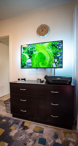 TV with AppleTV and Chromecast. Loaded with streaming services (Disney+, Hulu, ESPN, Netflix, Amazon Prime, HBO Go) and a wifi Printer in case you need it.