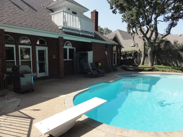 The pool is over 8 feet deep at the deep end and starts at about 3 feet at the shallow end.