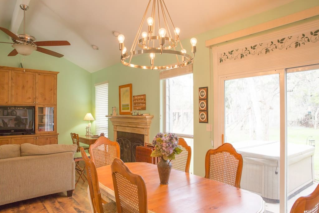 Enjoy your time in the open  Living Room, Dining Area, & well equipped Kitchen.   If you are fortunate enough to see them, wildlife, including various birds, pass through the backyard, at all hours.  The dining table is a great place to play games!