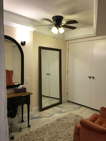 The North Carolina bedroom has a Murphy full bed that can be lowered if you need it and put up when a  larger dressing room is needed. It also has an outside door to the coy pond!