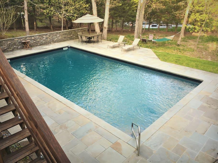 Blue stone deck surrounding heated pool
