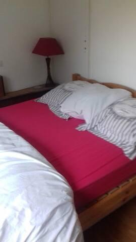 Chambre confortable dans appartement au RdC