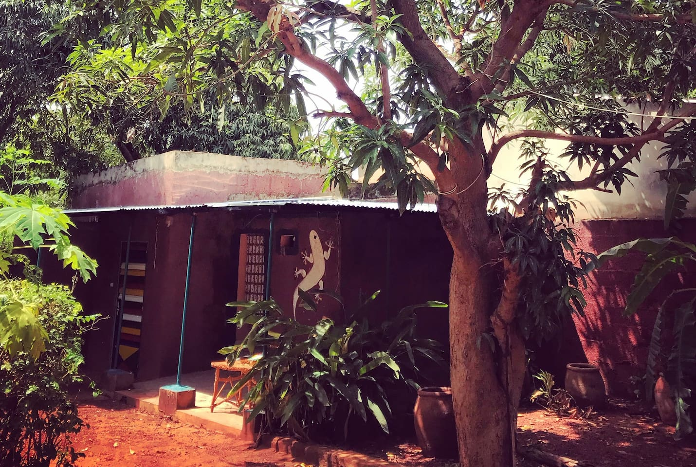 Private bungalow with shower, toilet and outside sitting area.