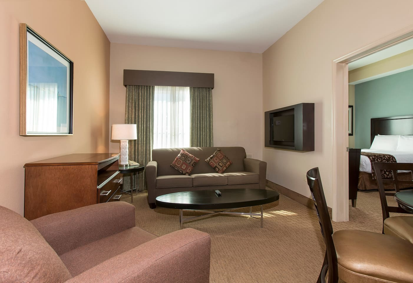 Relax on the sofa in our cozy and inviting suite after a day in the sun.