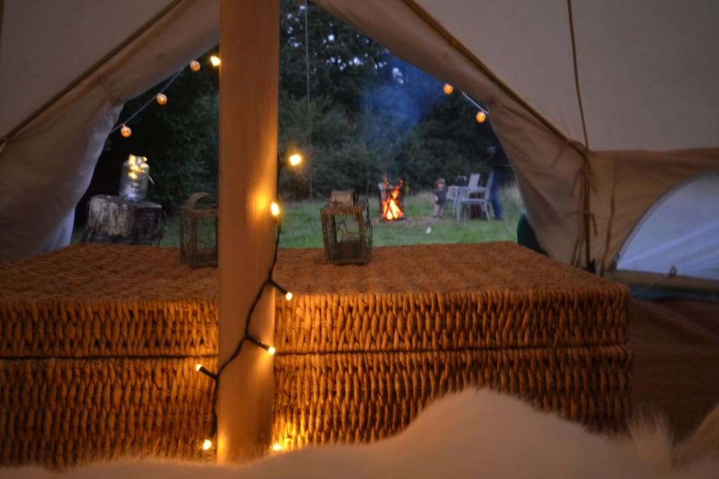 View to campfire from bell tent