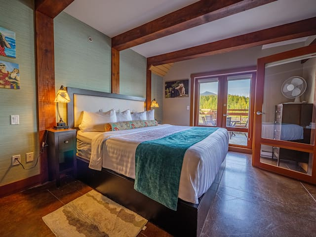 Luxurious king-sized bed in the master bedroom with hotel quality bedding