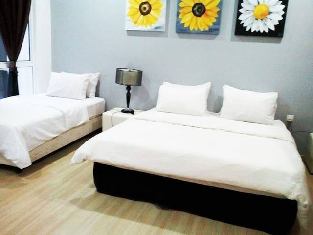 Bedroom 2  (1 king bed & 1 super single bed) for 3 pax