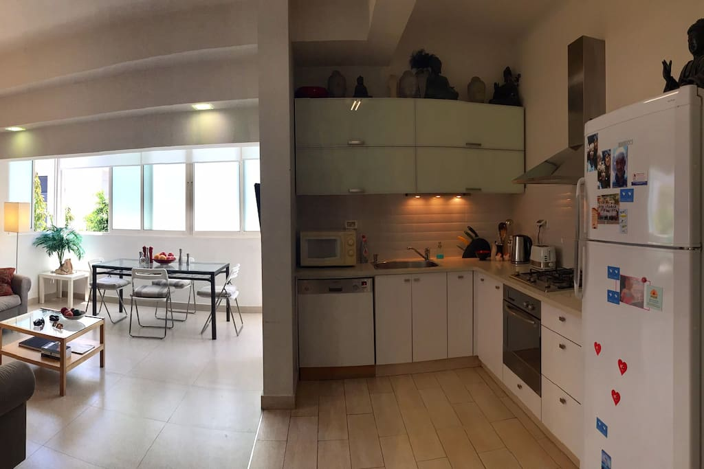 Fully equipped kitchen next to open plan sitting room.  Bright and airy