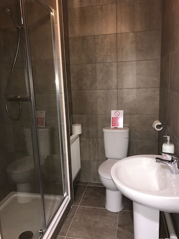 Smaller bathroom with walk in shower.