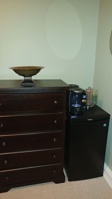 dresser, bar fridge, complimentary coffee or tea.