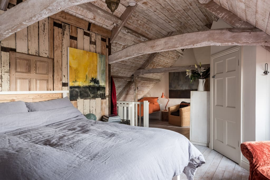 large attic room with king bed and two singles